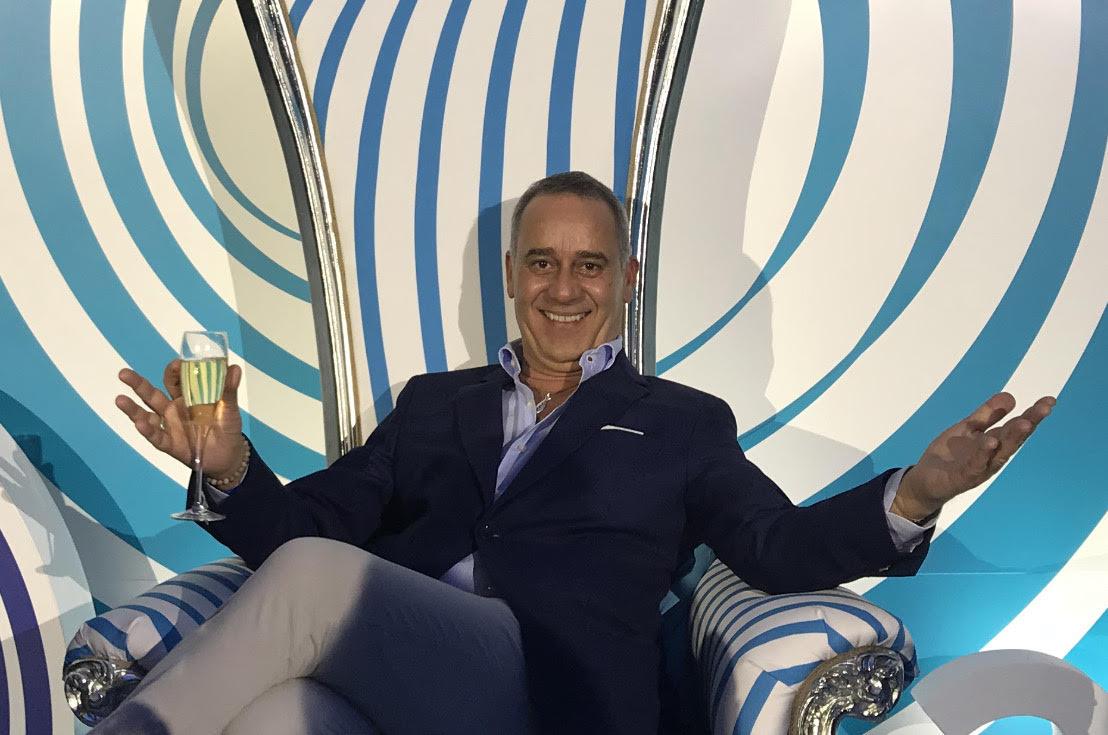 Paolo Macchiaroli sitting on an armchair